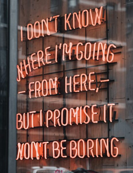 Neon sign in a window - sign says 'I don't know where I'm going from here but I promise it won't be boring'