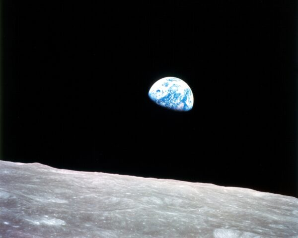 Planet Earth rising above the lunar surface.